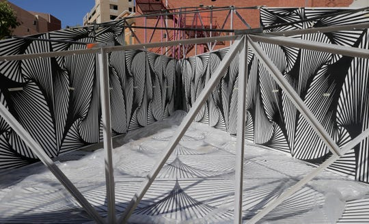 "El Paso artist Laura Turón began installation Wednesday of her mixed media art installation, ""Paradox Pyramid,"" which is being constructed at Arts Festival Plaza for this weekend's Chalk the Block event. Turon is being helped by several volunteers, including her husband, Adam Gonzalez, Staphany Garnica and others."