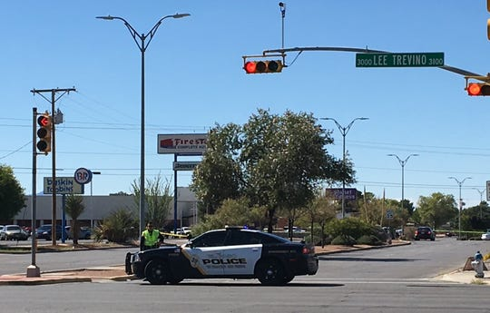 An El Paso police officer blocks the street Wednesday near the Pebble Hills Regional Command Center after an officer-involved shooting.