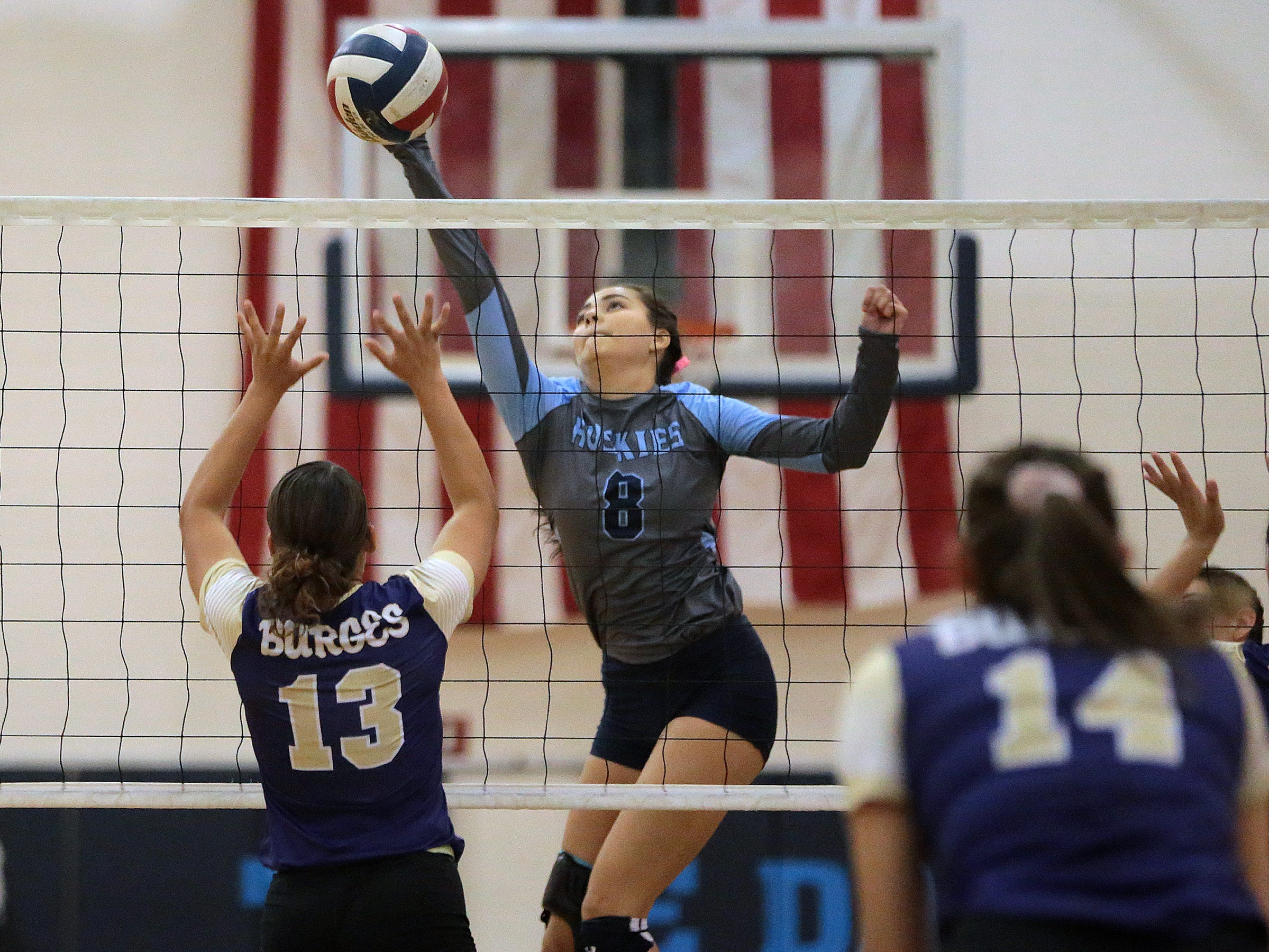 Chapin's Vivien Marquez hits a wayward ball over Meghan Cereceres of Burges.