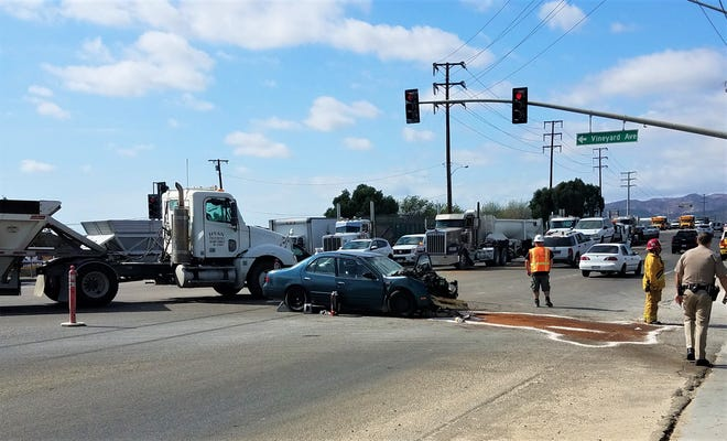 This was the scene Wednesday afternoon at Vineyard Avenue and Highway 118, where at least one person was killed in a crash between a car and a semi.