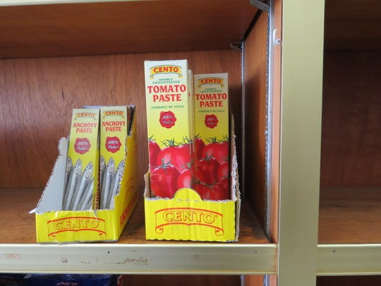 Tubes of anchovy paste and tomato paste are displayed on shelves at La Mantia Italian Grocery in Ventura. The combination deli and market was founded in 1992 by Peter La Mantia, who sold the business five years later to its current owner, Bill Clark.