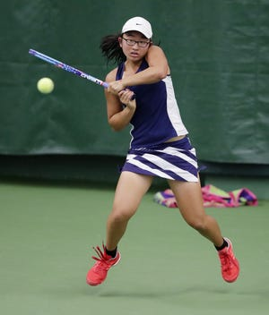 Stevens Point Area Senior High's Sabrina Tang hits a backhand return in a third round Division 1 singles match at the 2017 WIAA state girls tennis tournament. The Panthers senior will compete in the tournament this week for the fourth time in her prep career.