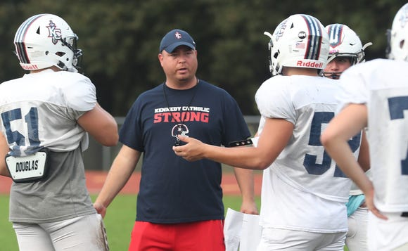 Kennedy Catholic football coach Dominick Tassone talks to his team during practice at Kennedy Catholic High School in Somers Oct. 9, 2018.