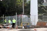 Workers construct a fence around the MTA cell tower in Tarrytown Oct. 10, 2018. Work at the site continues even though the MTA said they are looking into relocating the tower after the community has raised concerns about it being so close to Franklin Courts public-housing complex.