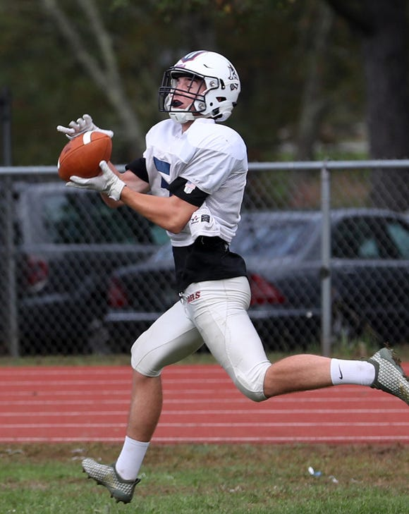 Kennedy Catholic's Tyler Outhouse catches a pass during practice at Kennedy Catholic High School in Somers Oct. 9, 2018.