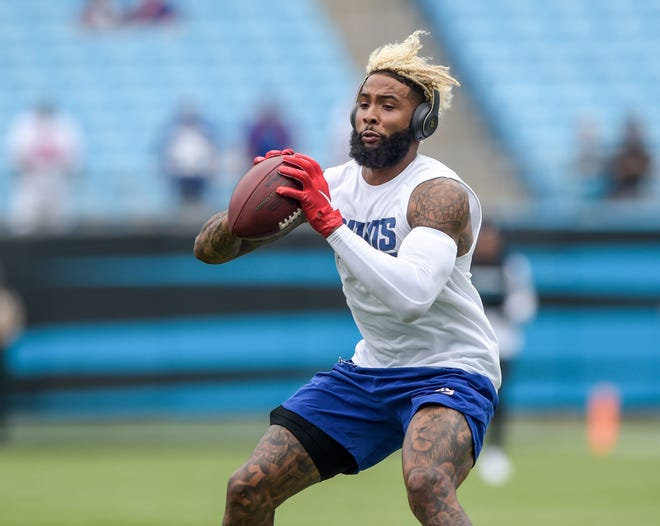 New York Giants wide receiver Odell Beckham warms up prior to an NFL Football game against the Carolina Panthers in Charlotte, N.C. Sunday, Oct. 7, 2018, (AP Photo/Mike McCarn)