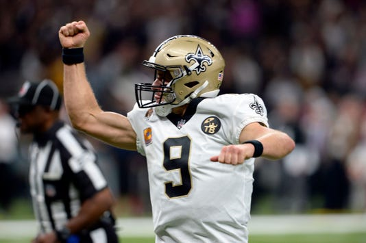 dbe131ba319 ... Drew Brees (9) reacts after throwing a touchdown pass in the first half  of an NFL football game against the Washington Redskins in New Orleans,  Monday, ...