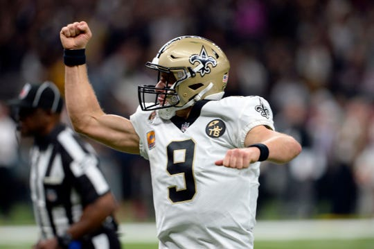 New Orleans Saints quarterback Drew Brees (9) reacts after throwing a touchdown pass in the first half of an NFL football game against the Washington Redskins in New Orleans, Monday, Oct. 8, 2018. Brees broke the NFL all-time passing yards record during the game. (AP Photo/Bill Feig)