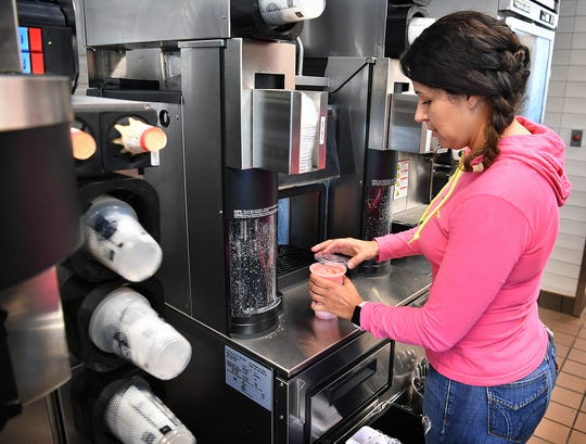 Assistant manager Alejandra Garcia makes a smoothie in the drinks area of the new McDonalds on Holliday Road which opens Thursday at 10:30 a.m.