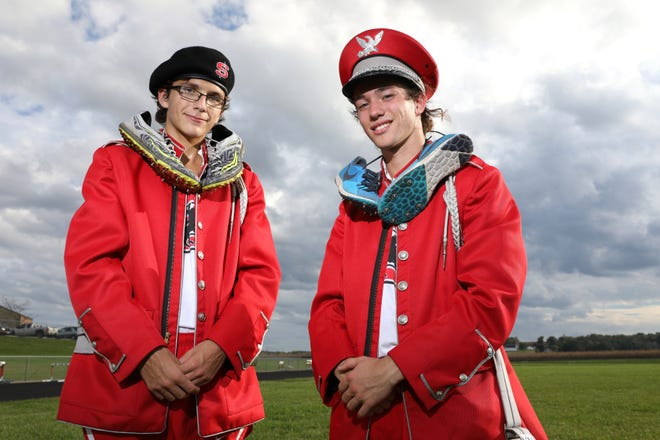 Sheridan High School cross country standouts Brandon Lanning, right, and William Wilke also play in the school's marching band.