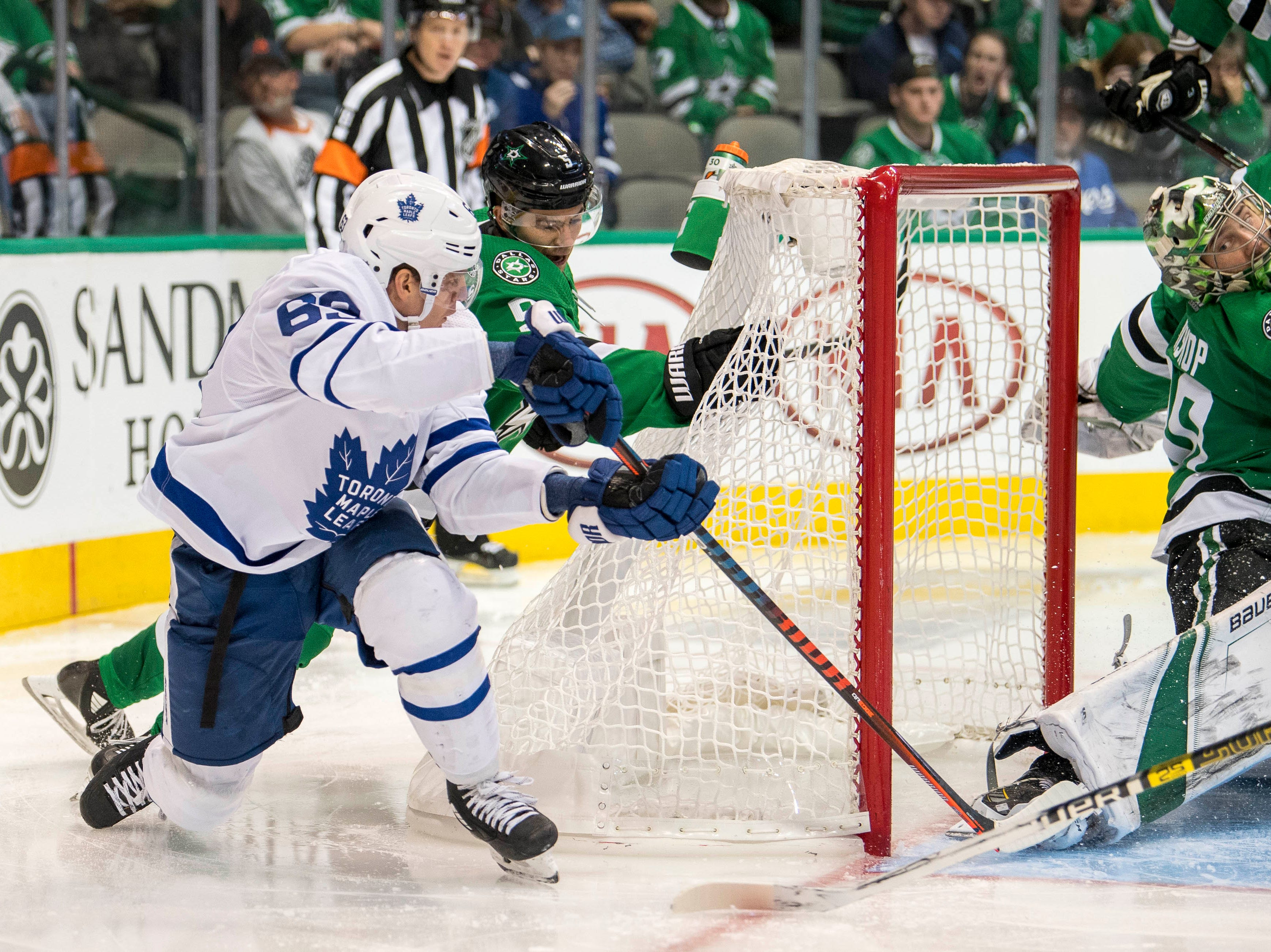 Oct. 9: Dallas Stars goaltender Ben Bishop (30) makes a save against Toronto Maple Leafs left wing Tyler Ennis (63) during the third period at the American Airlines Center.