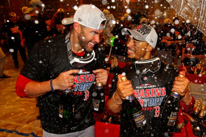 ALDS Game 4: Red Sox designated hitter J.D. Martinez and right fielder Mookie Betts celebrate beating the Yankees.
