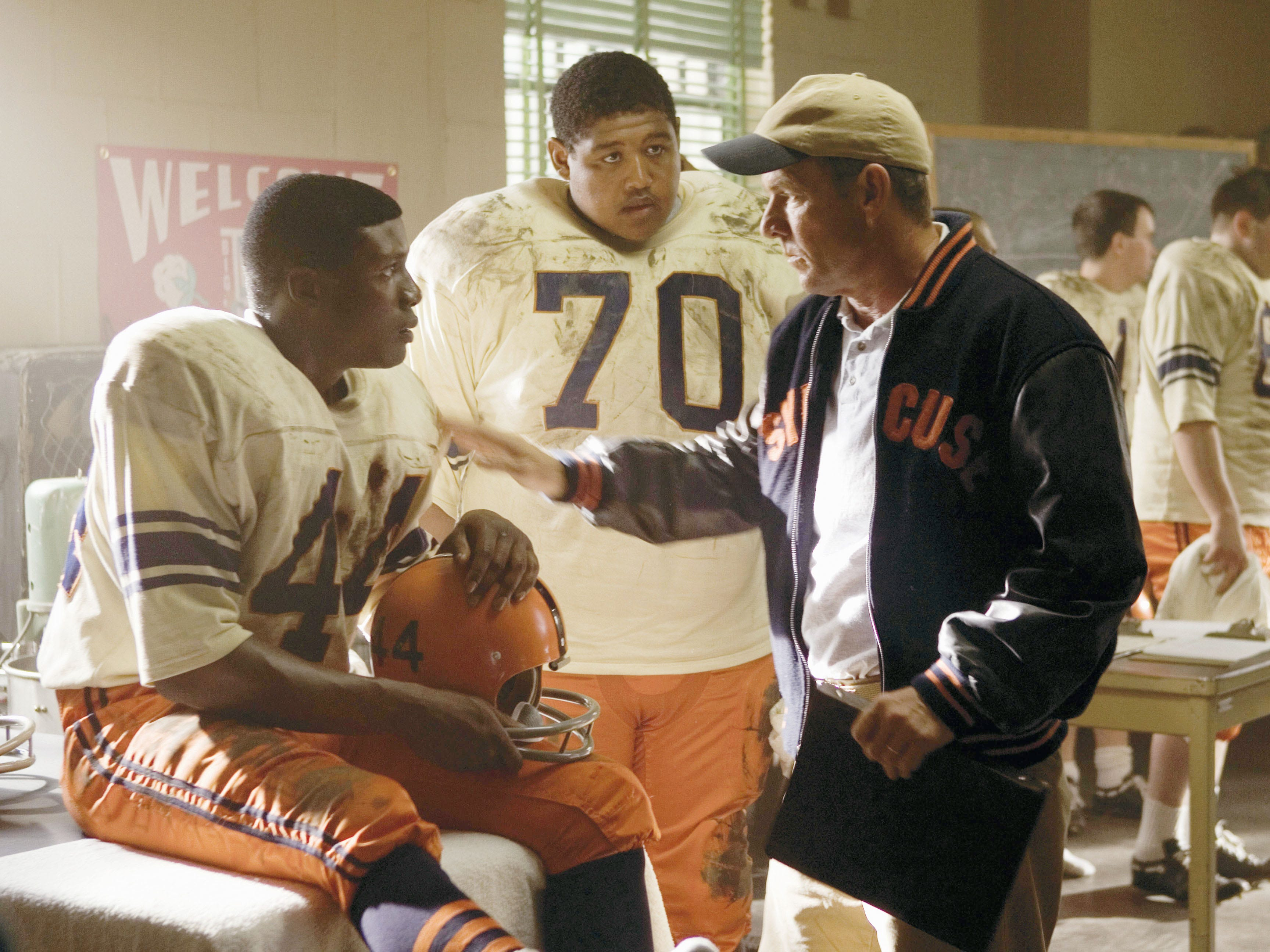"Rob Brown (left, with Omar Benson Miller and Dennis Quaid) stars as Ernie Davis, the first African-American to win the Heisman Trophy and the subject of ""The Express."""