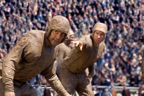 "George Clooney (left) and John Krasinski are 1920s footballers vying for the same woman's affections in ""Leatherheads."""