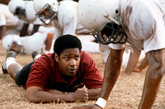 "Coach Herman Boone (Denzel Washington) integrates a high school football team in Virginia in ""Remember the Titans."""
