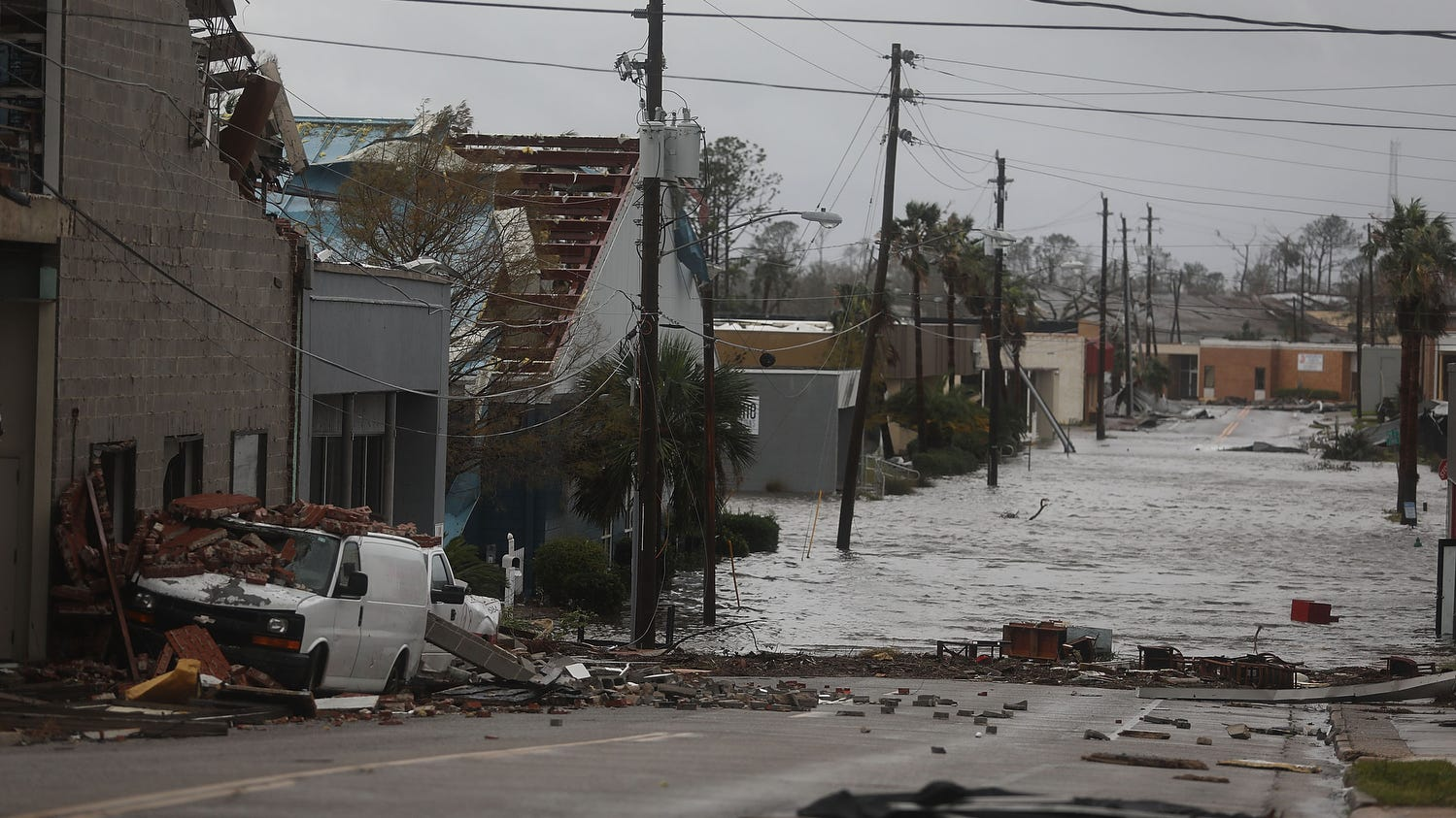 Damaged buildings and a flooded street are seen after hurricane Michael passed through Panama City.