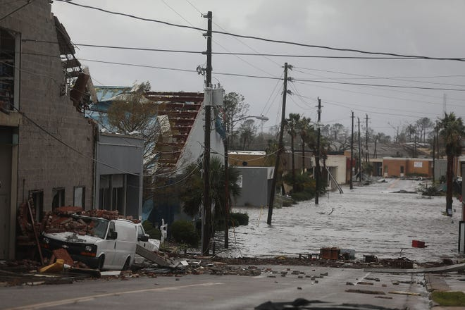 Damaged buildings and a flooded street are seen Oct. 10, 2018, after hurricane Michael passed through Panama City in Florida's Panhandle.