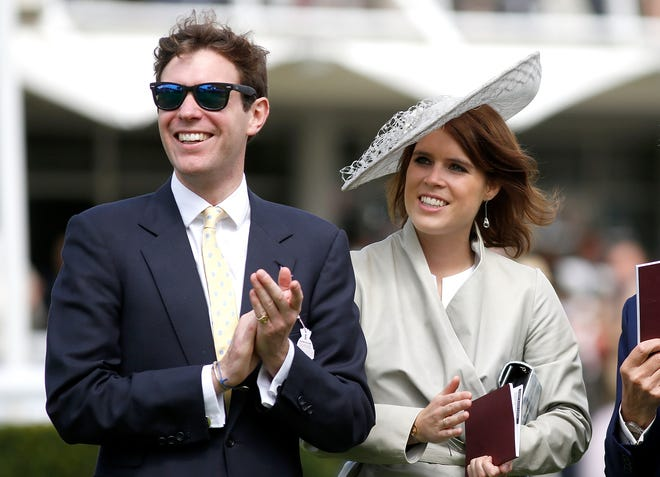 :  Princess Eugenie and Jack Brooksbank at the Qatar Goodwood Festival at Goodwood Racecourse on July 30, 2015 in Chichester, England.