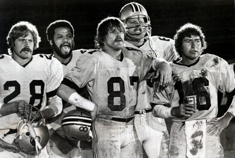 "Nick Nolte (center) is a wide receiver who leads a hard-living football squad in ""North Dallas Forty."""