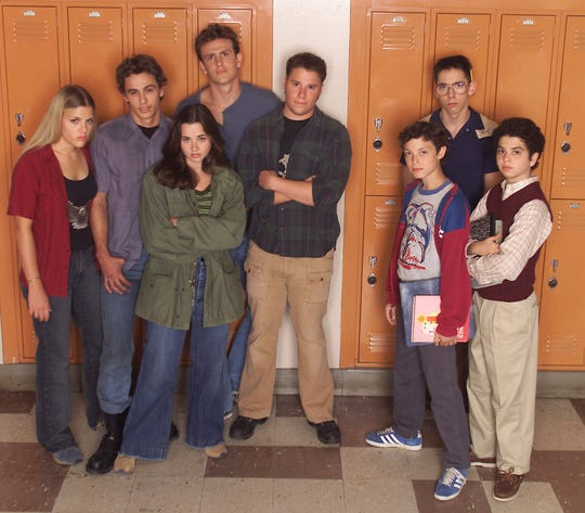 "Busy Philipps far left, with her 'Freaks and Geeks"" co-stars James Franco, Linda Cardellini, Jason Segal, Seth Rogen, John Francis Daley, Martin Starr and Samm Levine. (Photo: PAUL DRINKWATER/Associated Press)"