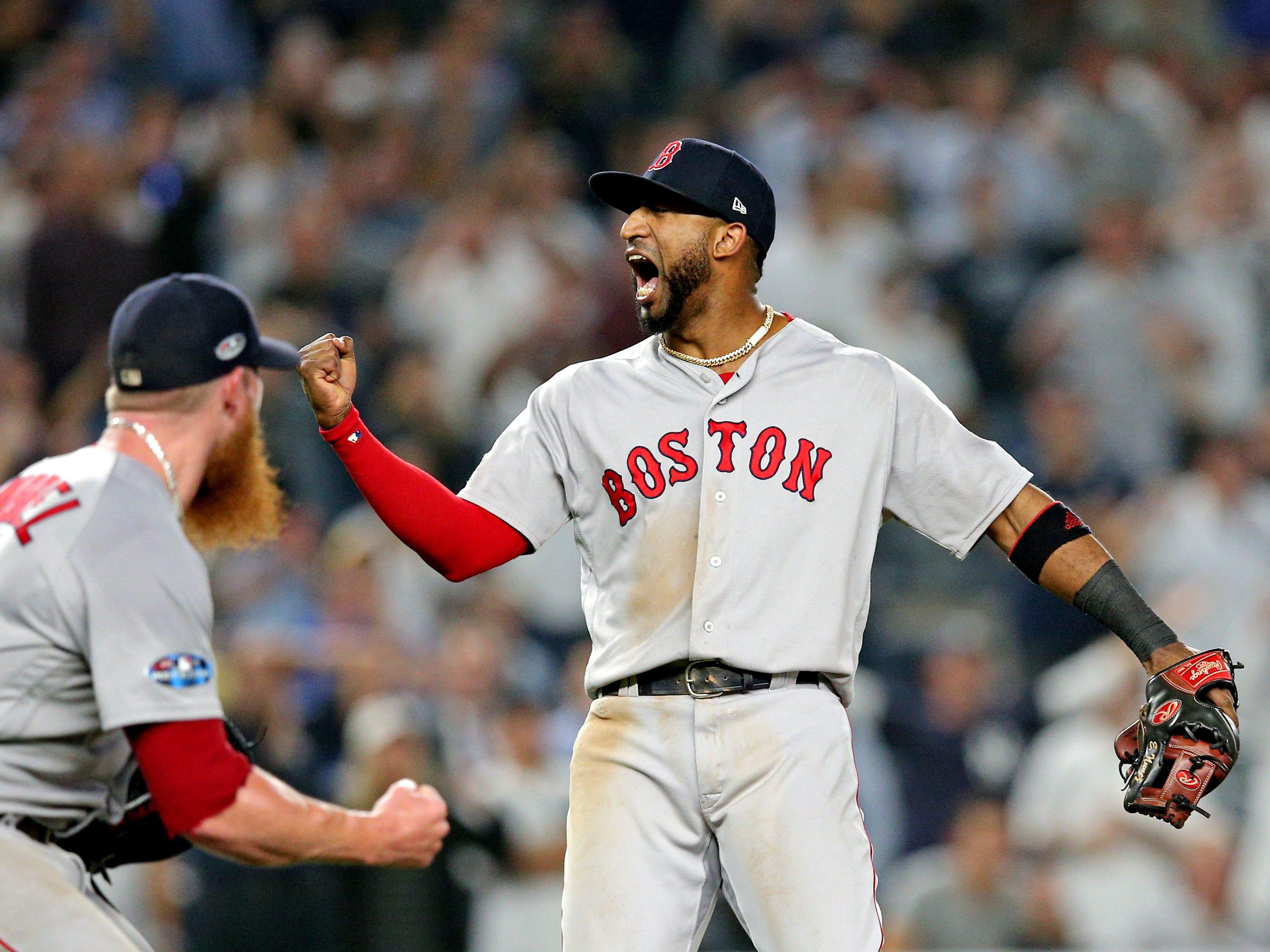 ALDS Game 4: Red Sox third baseman Eduardo Nunez and closer Craig Kimbrel celebrate the final out.