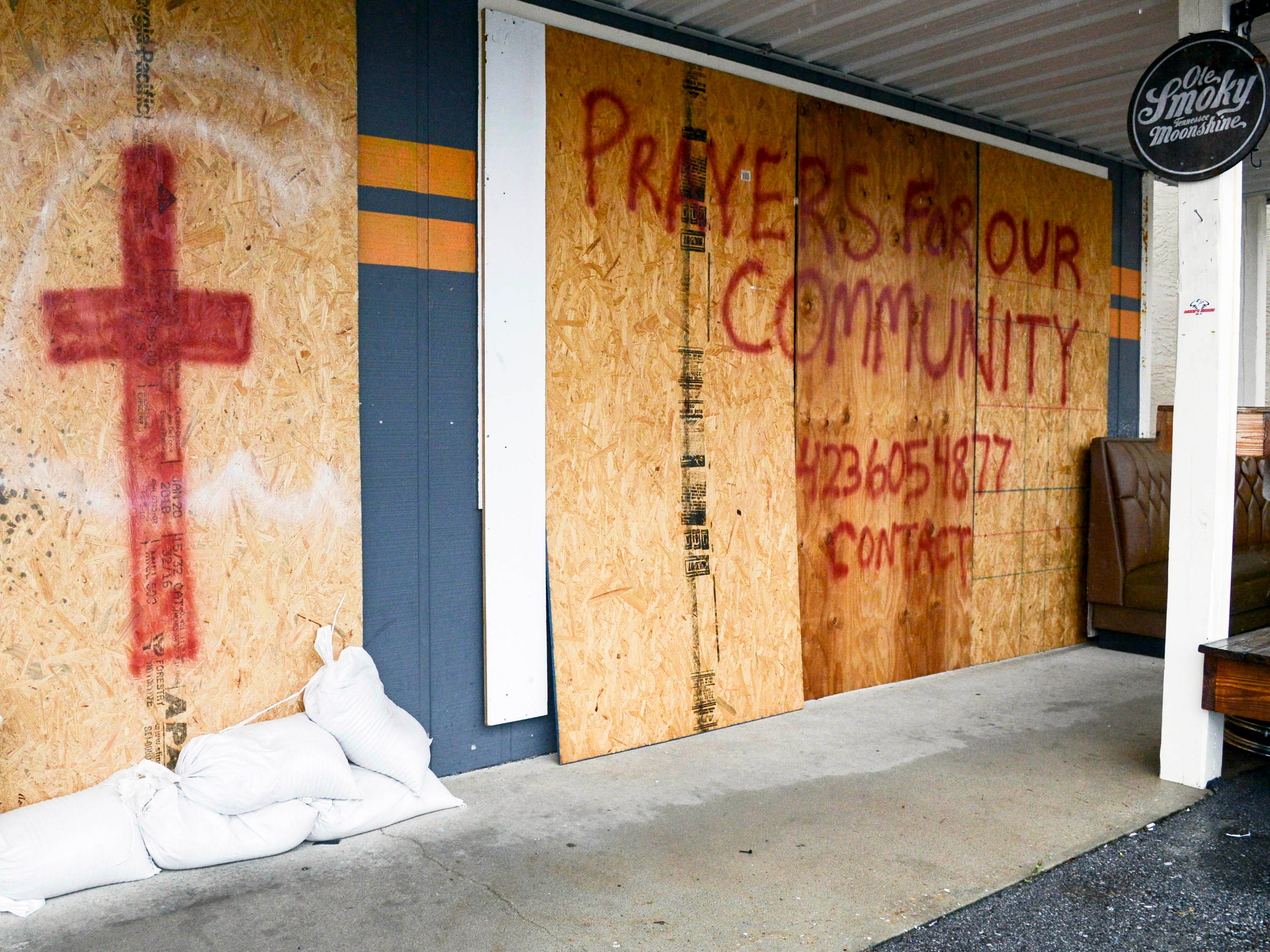 Oct 10, 2018; Panama City, FL, USA; Sandbags, boards and a prayer request guard the front of South Iron Customs motorcycle shop on Panama City Beach. Mandatory Credit: Craig Bailey/FLORIDA TODAY via USA TODAY NETWORK ORIG FILE ID:  20181008_ajw_usa_121.jpg