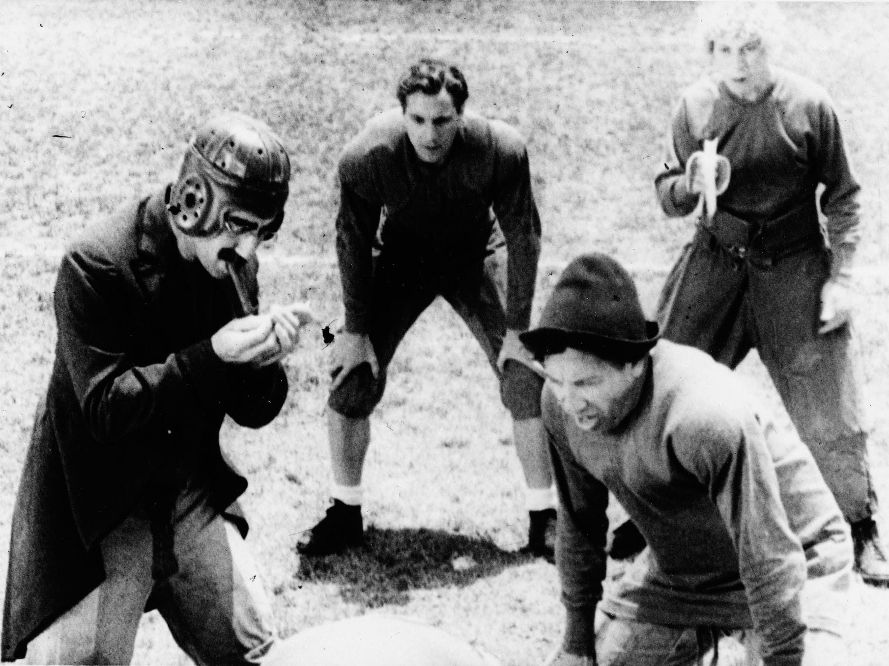 "College professor Quincy Adams Wagstaff (Groucho Marx, left) gets ready for a play with his football team (including Zeppo Marx, Chico Marx and Harpo Marx) in the big game against a rival school in ""Horse Feathers."""