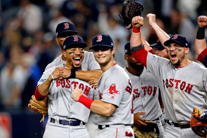 The Red Sox celebrated beating the Yankees to advance to the ALCS.