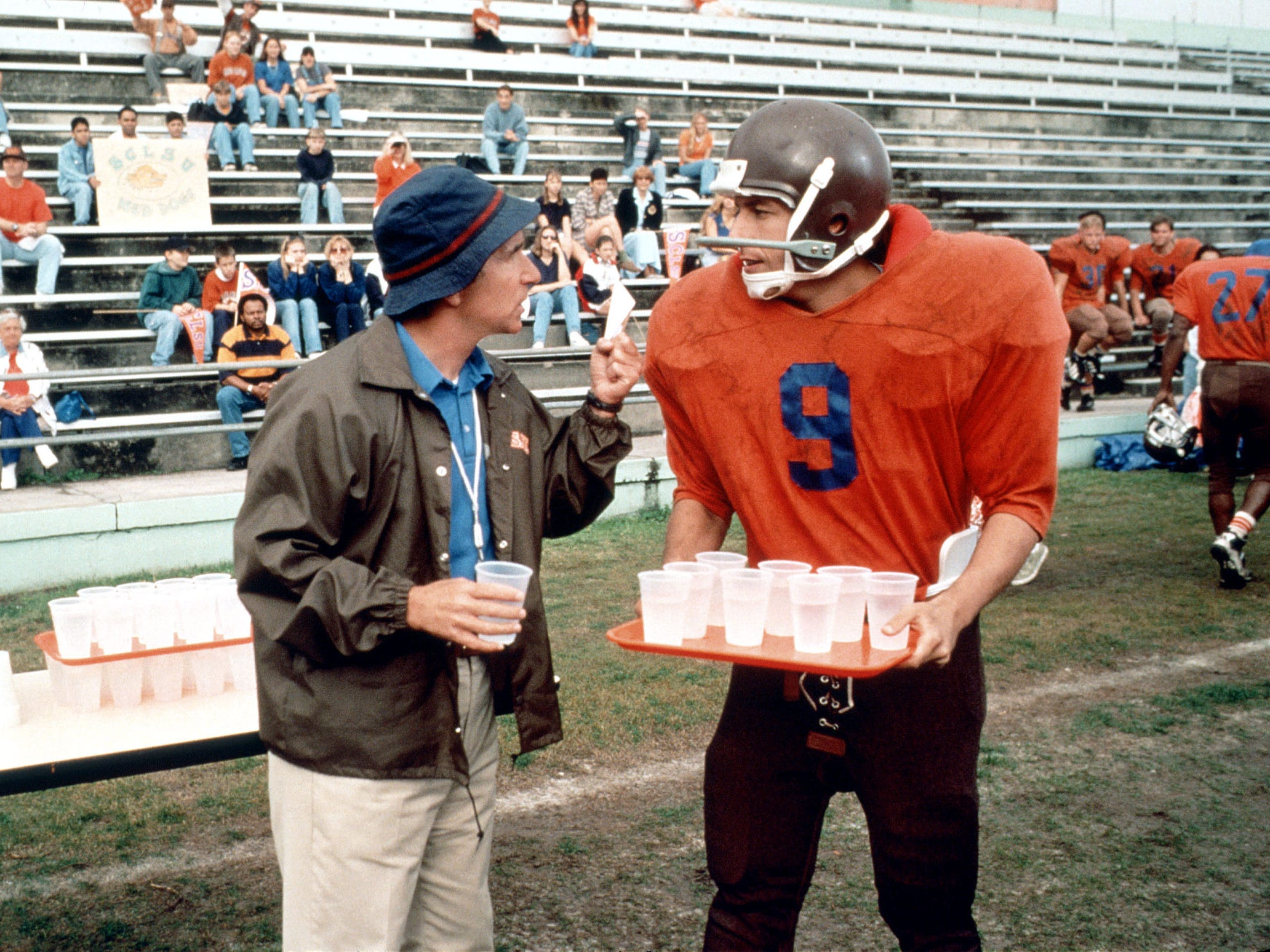 "A bullied college waterboy (Adam Sandler, with Henry Winkler) finally gets in the game as a football wunderkind in ""The Waterboy."""