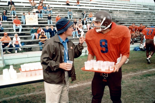 """A bullied college waterboy (Adam Sandler, with Henry Winkler) finally gets in the game as a football wunderkind in """"The Waterboy."""""""