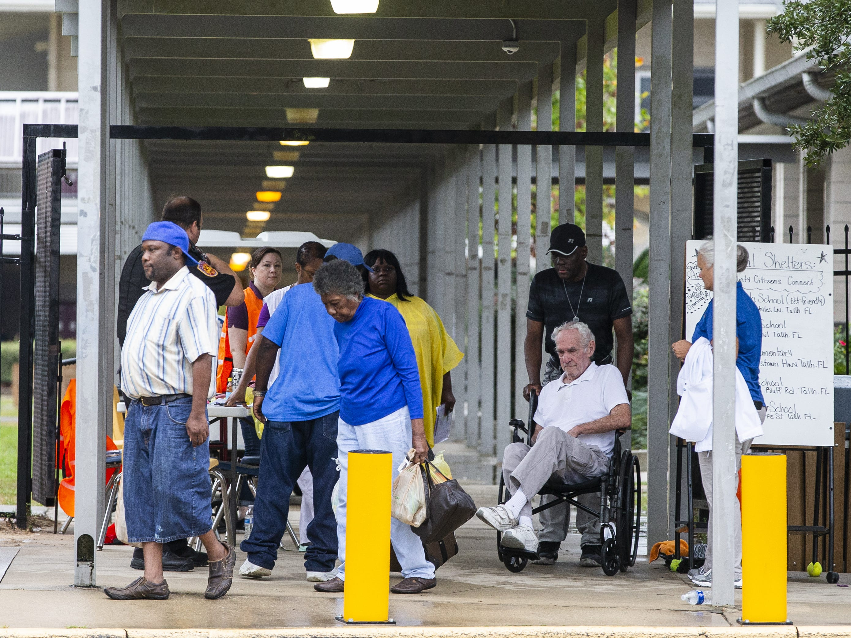 TALLAHASSEE, FL - OCTOBER 10: People arrives at a special needs shelter at Florida High School as Hurricane Michael approaches on October 10, 2018 in Tallahassee, Florida. The hurricane is forecast to hit the Florida Panhandle at a possible category 4 storm.  (Photo by Mark Wallheiser/Getty Images) ORG XMIT: 775240672 ORIG FILE ID: 1048878464
