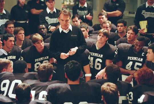 "Billy Bob Thornton (center) is the fiery coach of the Permian High squad in ""Friday Night Lights."""