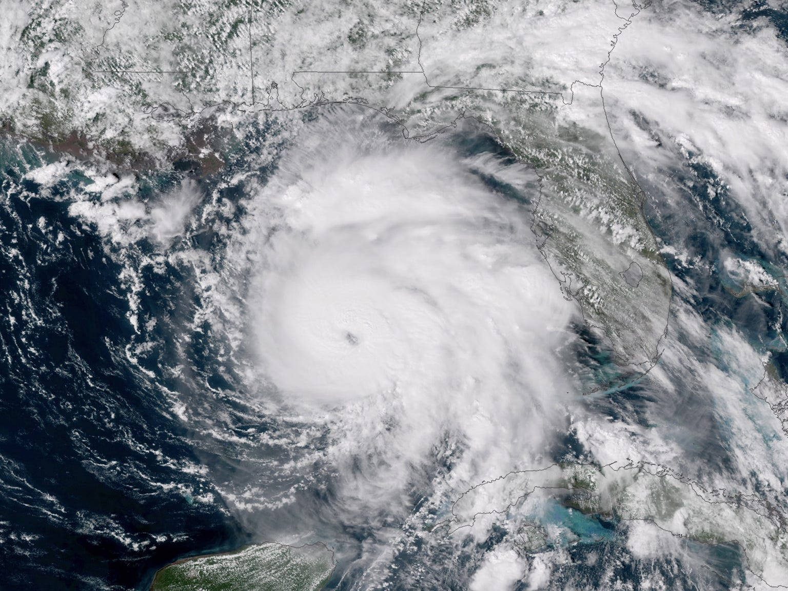 epa07082394 A handout photo made available by the US National Oceanic and Atmospheric Administration (NOAA) on 09 October 2018 shows a Geo-Color satellite image of hurricane Michael as it moves north-northwest over the southeastern Gulf of Mexico. The latest forecast from the National Hurricane Center (NHC) shows the center of Michael moving across the eastern Gulf of Mexico through the night of 09 October 2018. On 10 October 2018, the center of the storm is forecast to move inland over the Florida Panhandle, bringing dangerous storm surge, hurricane-force winds and heavy rainfall. More than 370,000 people in Florida have been ordered to evacuate.  EPA-EFE/NOAA / HANDOUT  HANDOUT EDITORIAL USE ONLY/NO SALES