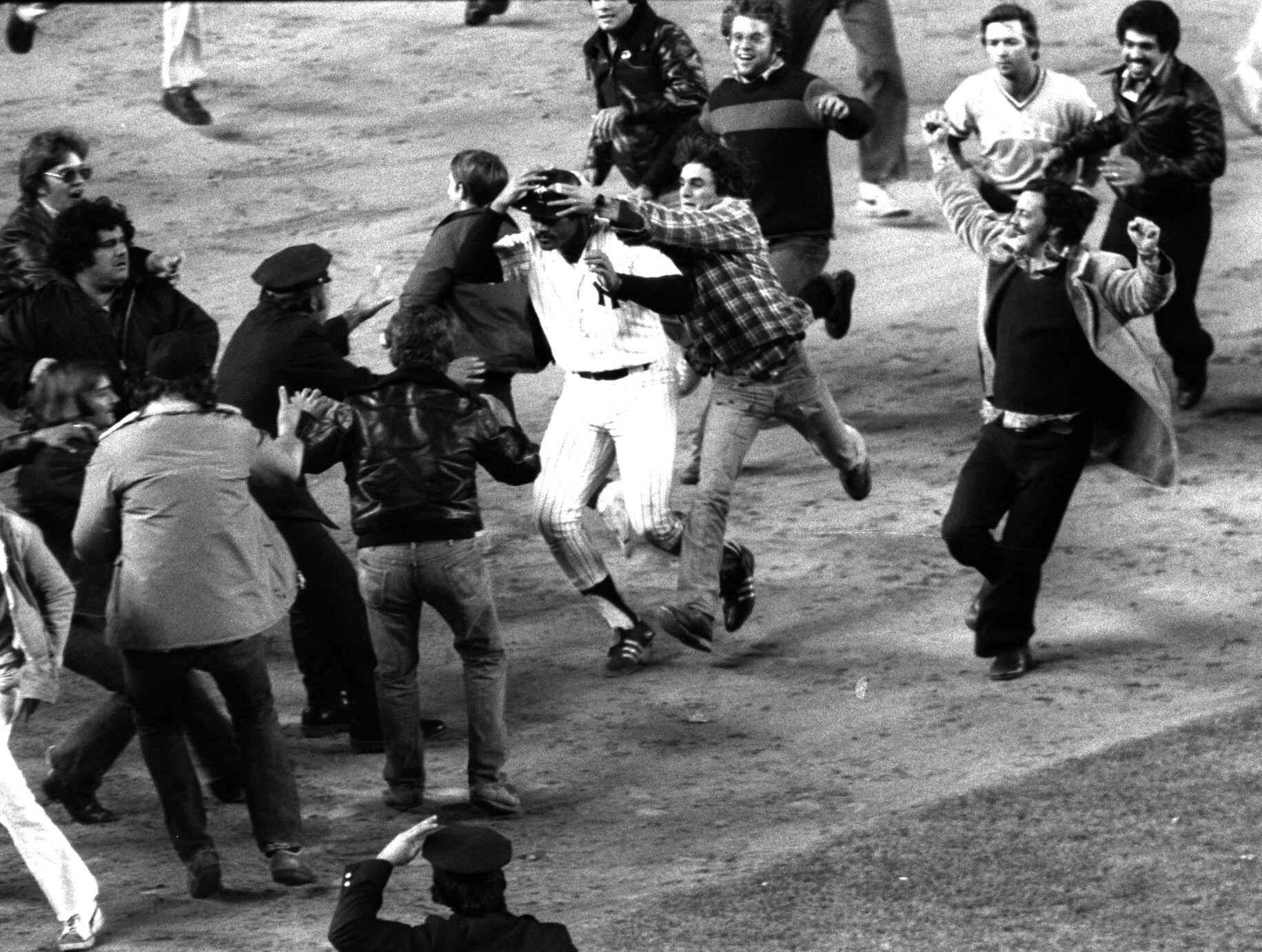 1976 ALCS Game 5: Chris Chambliss hit a walk-off solo homer against the Royals to put the Yankees in the World Series, and fans mobbed the field before he could even circle the bases.