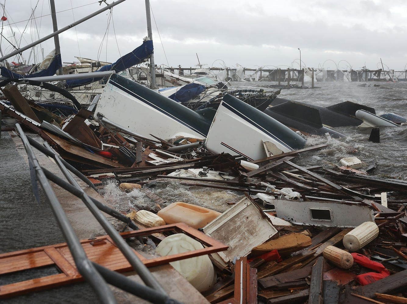 Boats that were docked are seen in a pile of rubble after hurricane Michael passed through the downtown area in Panama City, Wednesday.