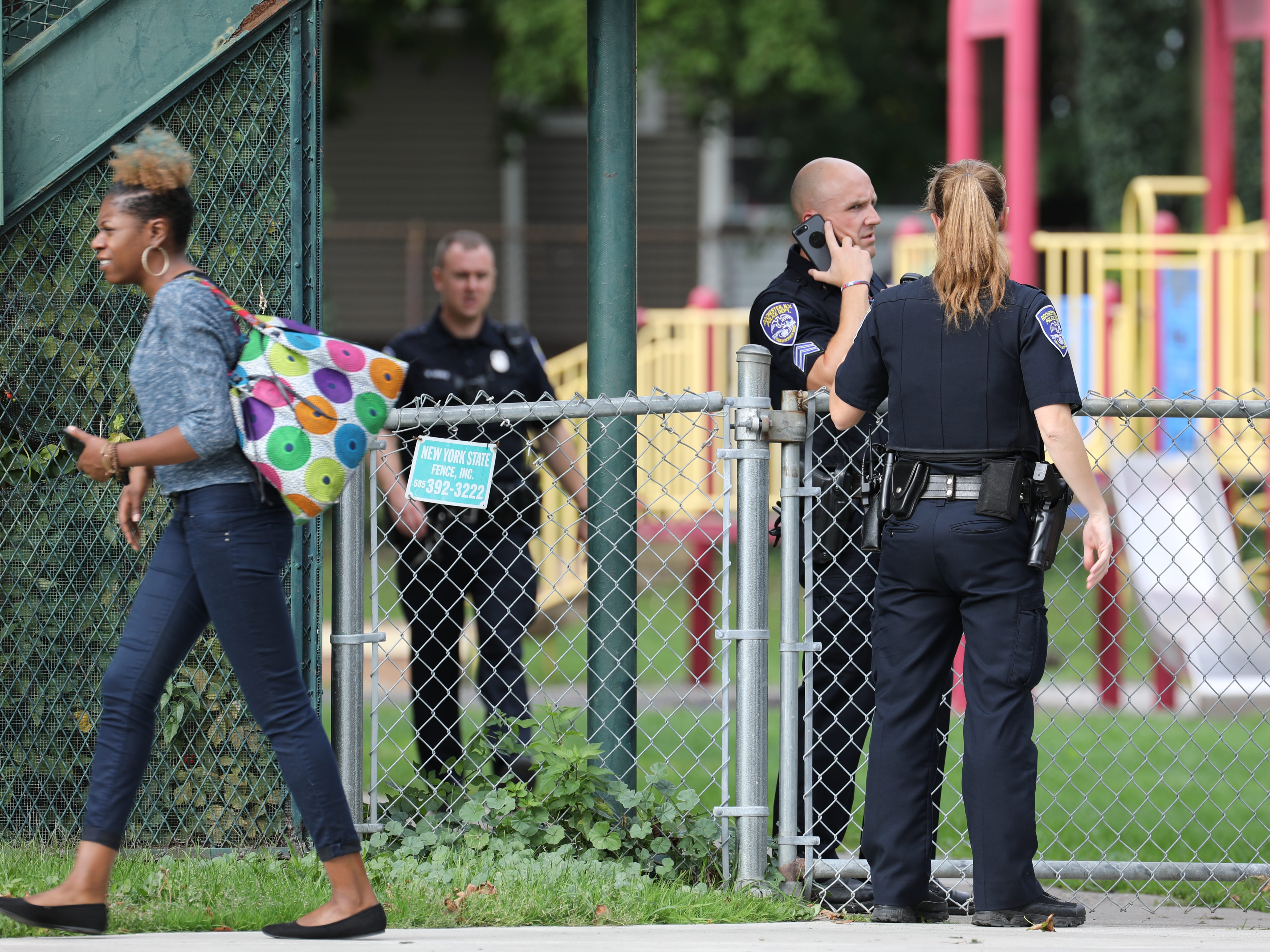 Police investigate a shooting at School 25, in Rochester, N.Y., Wednesday, Oct. 10, 2018.