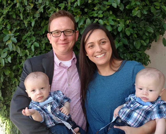 Brittney Schneider with her husband, Trevor, and their twins, Ethan and Evan. The Schneiders spent more than 2 and a half years at fertility clinics and conceived through IVF.