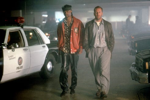 "A disgraced ex-football star (Damon Wayans, left) and a private eye (Bruce Willis) dig up shady shenanigans while investigating a murder in ""The Last Boy Scout."""