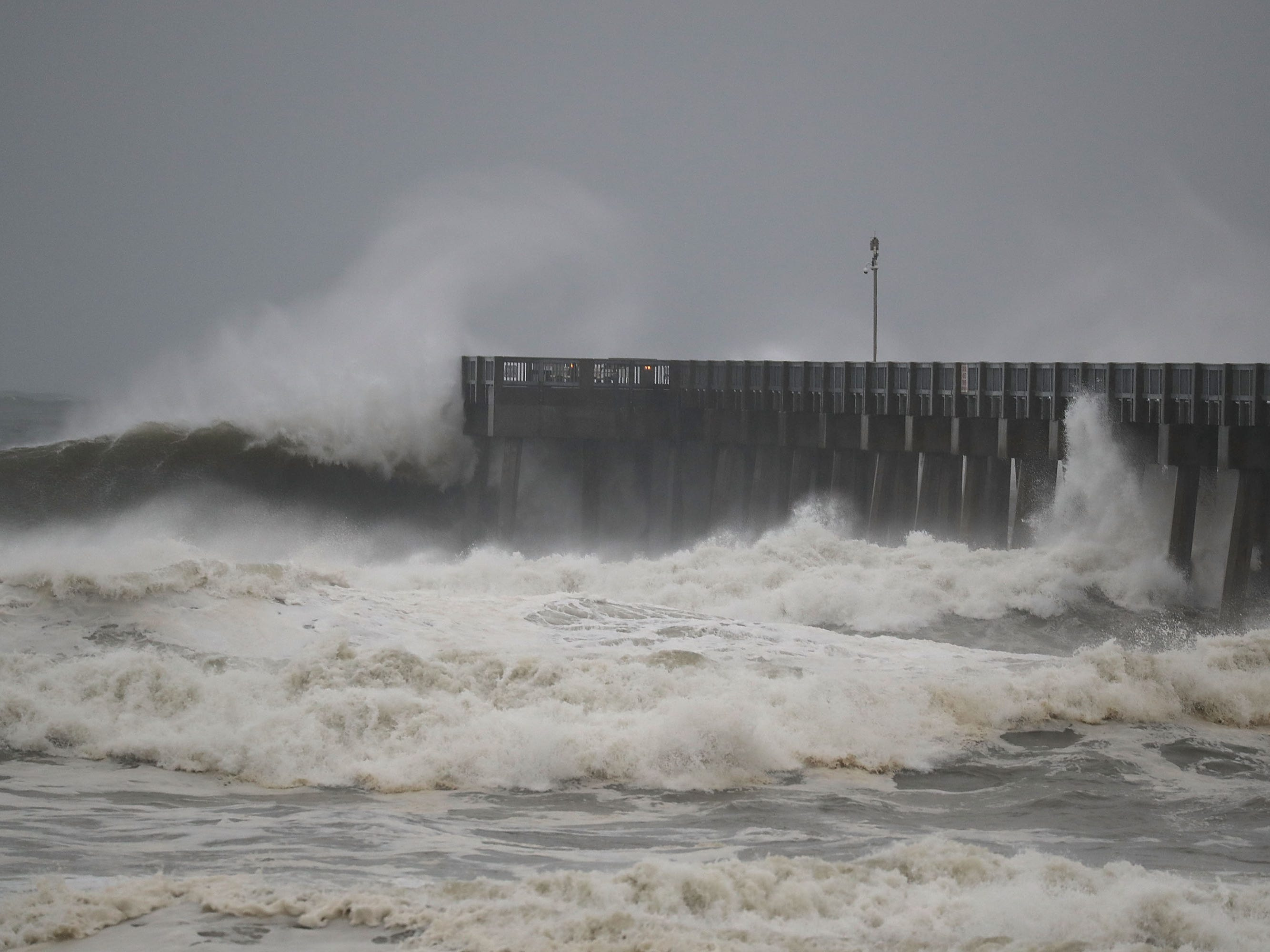 PANAMA CITY BEACH, FL - OCTOBER 10:  Waves crash along a pier as the outerbands of  hurricane Michael arrive on October 10, 2018 in Panama City Beach, Florida. The hurricane is forecast to hit the Florida Panhandle at a possible category 4 storm.  (Photo by Joe Raedle/Getty Images) ORG XMIT: 775240672 ORIG FILE ID: 1048822148