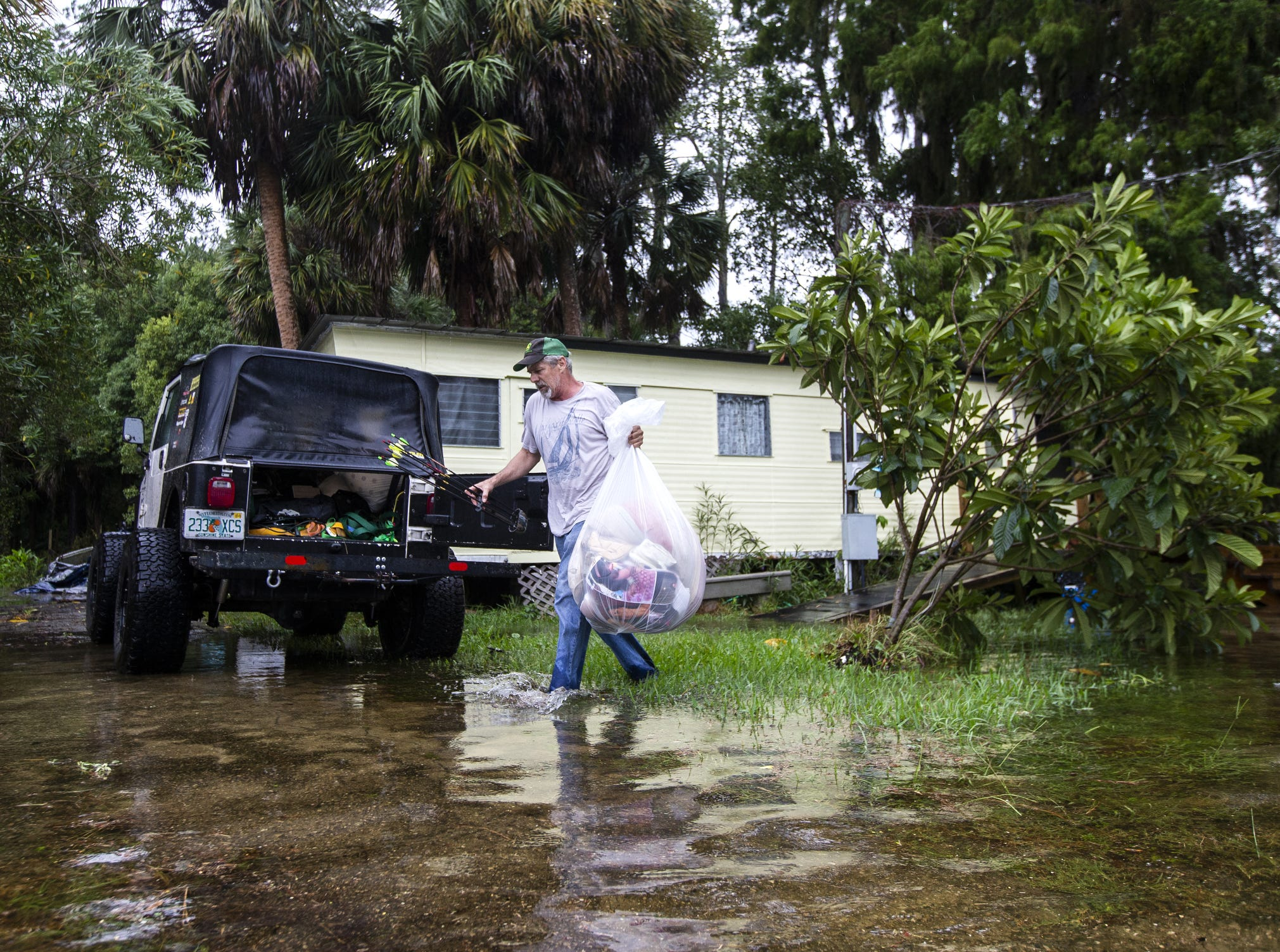 Mitchell Pope tries to salvage what he can from his mobile home as Hurricane Michael pushes the storm surge up the Wakulla and Saint Marks Rivers which come together here, Wednesday, in Saint Marks, Fla.