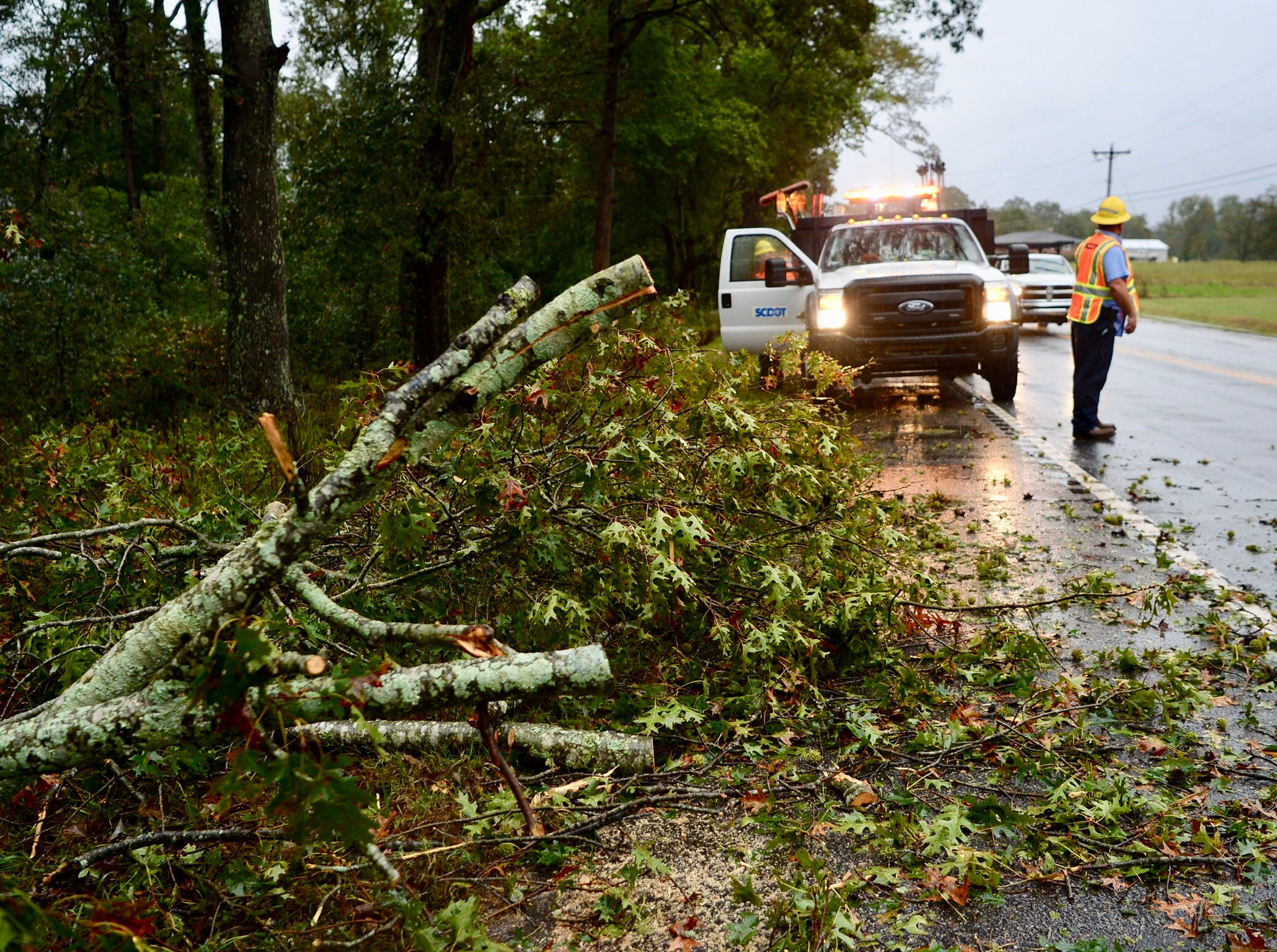 SCDOT worker Chris Barrick at the scene of a downed tree on US 29 and Dorchester Road in Anderson on Thursday, Oct. 11, 2018, following heavy rain triggered by Tropical Storm Michael.