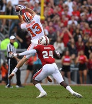 Clemson wide receiver Hunter Renfrow (13)  catches a pass over NC State safety Shawn Boone (24) during the 1st quarter on Saturday, November 4, 2017 at N.C. State's Carter Finley Stadium in Raleigh, N.C.