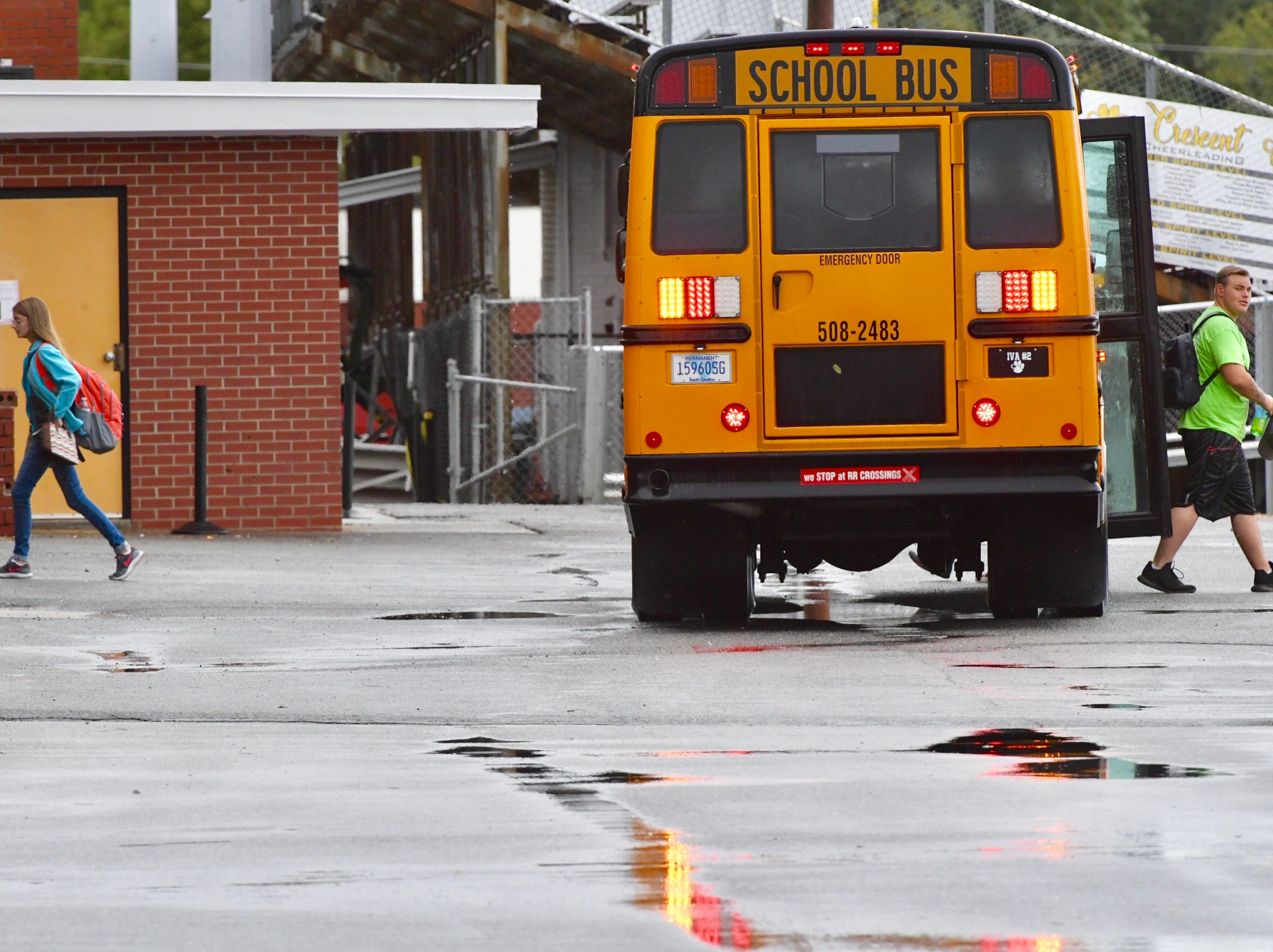 Anderson School District Three buses bring students in after schools were delayed by two hours because of stormy conditions caused by Tropical Storm Michael on Thursday, Oct. 11, 2018.
