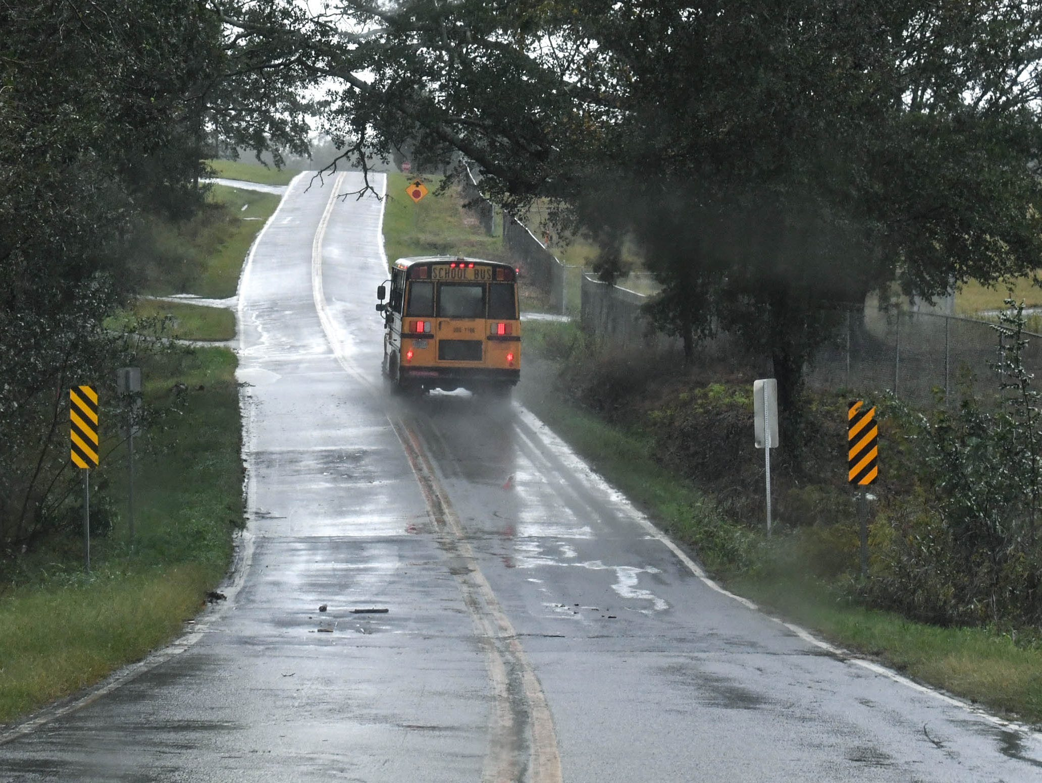 A school bus bringing Crescent High School students drives along Good Hope Church Road in Iva on Thursday. Anderson School District Three had a two-hour delay due to  the rain from Hurricane Michael.
