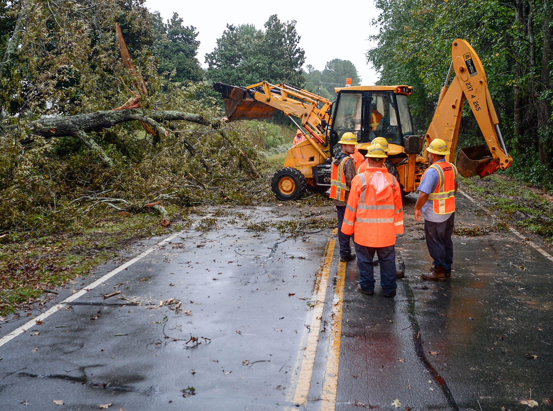 SCDOT workers clean up a fallen oak tree along Cherokee Road near SC 81 North in Anderson on Thursday. Rainfall from Hurricane Michael came through Anderson County on Thursday morning.