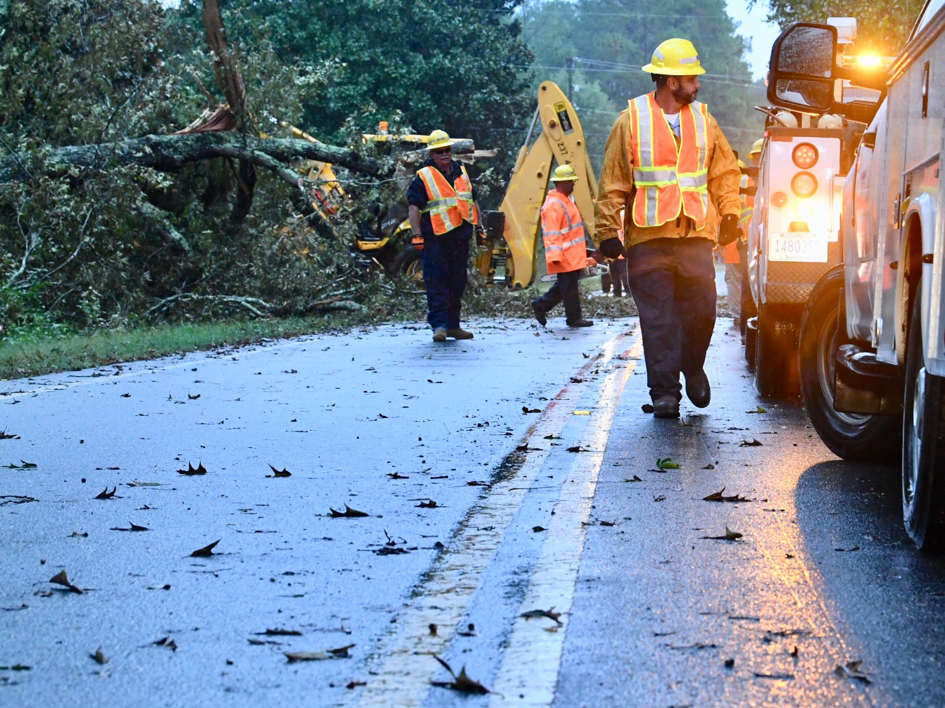 An SCDOT team works to clear Cherokee Road off South Carolina 81 on Thursday, Oct. 11, 2018, after heavy rain caused by Tropical Storm Michael triggered wind gusts and rain.