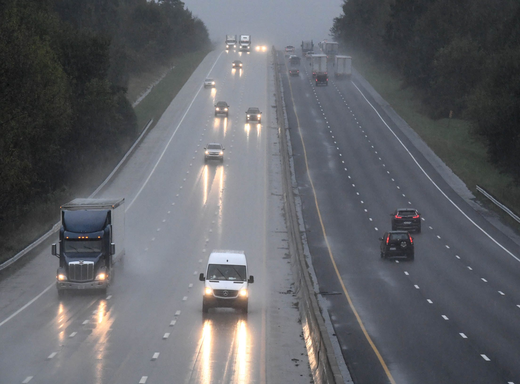 Cars and trucks drive through Anderson County on I-85 on Thursday morning, when rainfall from Hurricane Michael came through.