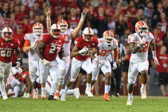 Clemson running back Tavien Feaster (28) races 89 yards to score against NC State during the 3rd quarter Saturday, November 4, 2017 at N.C. State's Carter Finley Stadium in Raleigh, N.C.