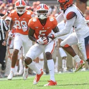 Clemson wide receiver Tee Higgins (5) catches a fourth-and-six yard play catch from quarterback Chase Brice (7) during the fourth quarter in Memorial Stadium on Saturday, September 29, 2018.