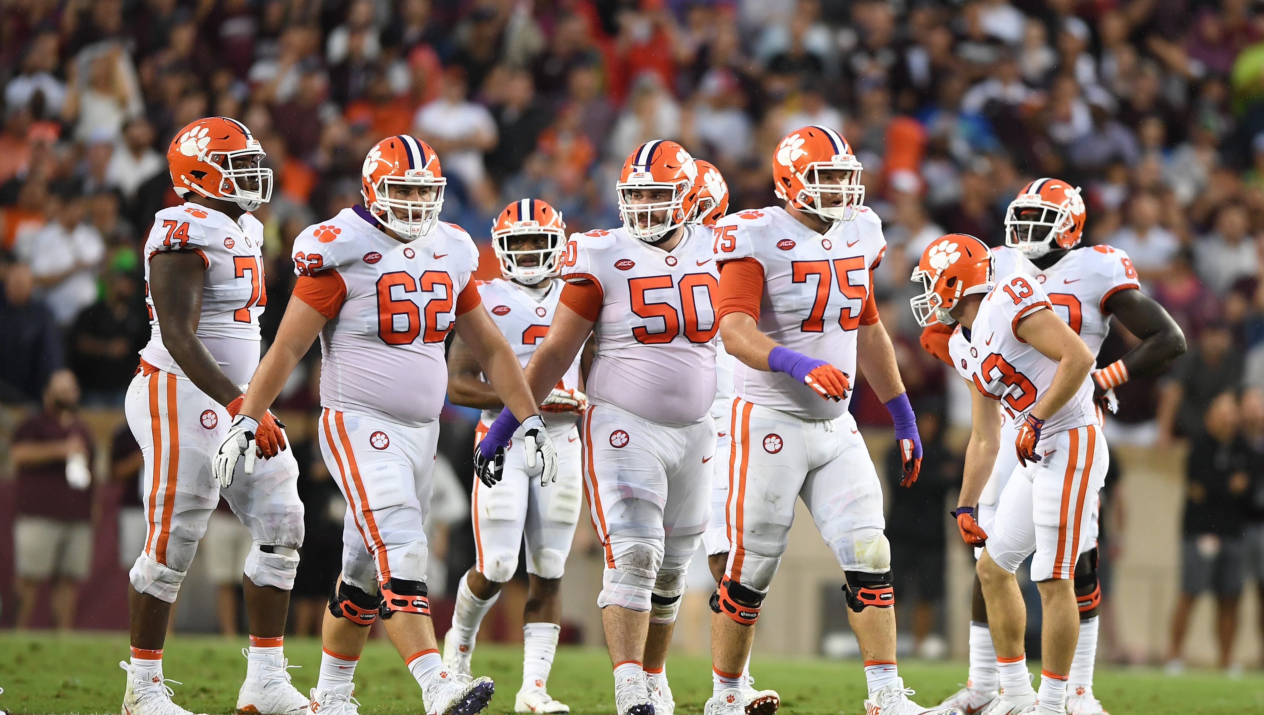 From left, Clemson offensive guard John Simpson (74), offensive lineman Cade Stewart (62), center Justin Falcinelli (50), and offensive lineman Mitch Hyatt (75) during the 2nd quarter at Texas A&M's Kyle Field in College Station, TX Saturday, September 8, 2018.